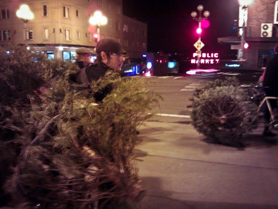 by the public market with christmas trees