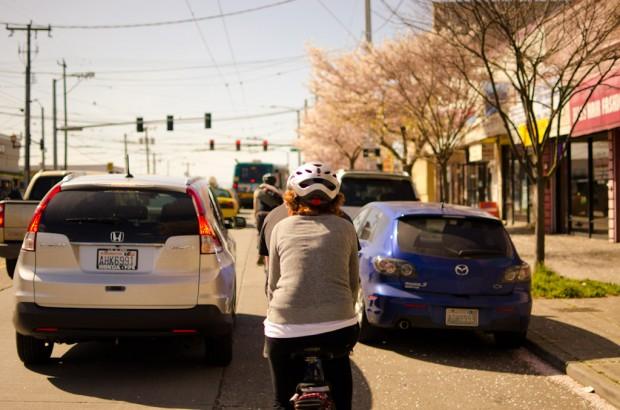 biking past cherry blossoms