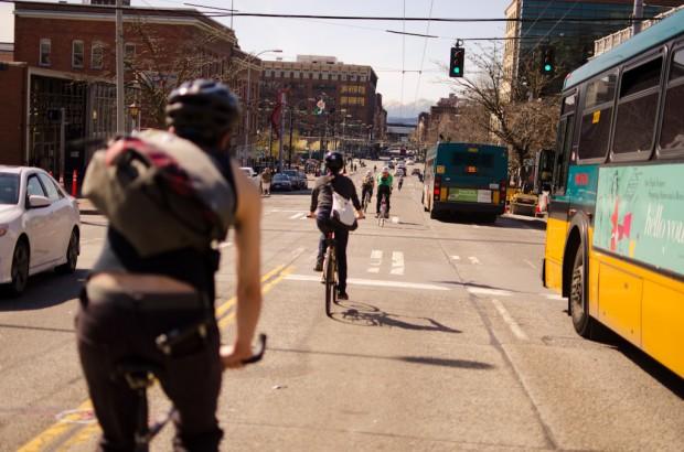biking past buses