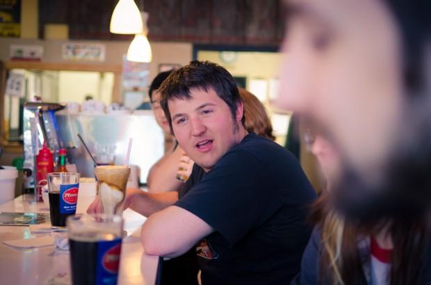 nick reacting at a diner